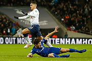 Tottenham Hotspur midfielder Erik Lamela (11) fouls Chelsea defender Marcos Alonso (3) but continues towards goal during the EFL Cup semi-final match between Tottenham Hotspur and Chelsea at Wembley Stadium, London, England on 8 January 2019.