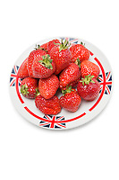 Fresh strawberries in plate over white background