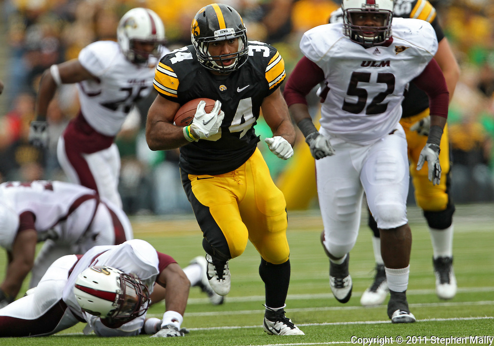 September 24, 2011: Iowa Hawkeyes running back Marcus Coker (34) on a run during the third quarter of the game between the Iowa Hawkeyes and the Louisiana Monroe Warhawks at Kinnick Stadium in Iowa City, Iowa on Saturday, September 24, 2011. Iowa defeated Louisiana Monroe 45-17.