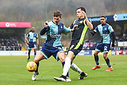 Wycombe Wanderers Midfielder Dominic Gape (4) and Carlisle United Midfielder Mike Jones (8) battle for the ball during the EFL Sky Bet League 2 match between Wycombe Wanderers and Carlisle United at Adams Park, High Wycombe, England on 3 February 2018. Picture by Stephen Wright.