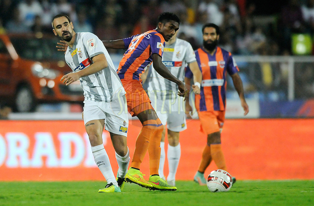 Cavin Peter Lobo of Atletico de Kolkata and Lenny Rodrigues of FC Pune City fight for the ball during match 44 of the Hero Indian Super League between FC Pune City and Atletico de Kolkata FC held at the Shree Shiv Chhatrapati Sports Complex Stadium, Pune, India on the 29th November 2014.<br /> <br /> Photo by:  Pal Pillai/ ISL/ SPORTZPICS