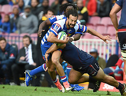 Cape Town-180427 Dillyn Leyds of Stomers challenged by  Rebels player in a Super 15 match played at Newlands stadium.photograph:Phando Jikelo/African News Agency/ANA