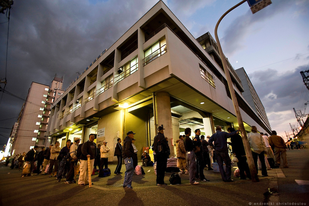 Homeless people queing outside Airin Labor Welfare Center for tickets to night shelters in the area.