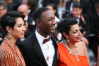 Aloe Blacc (center) at The Paperboy gala screening red carpet at the 65th Cannes Film Festival France. Thursday 24th May 2012 in Cannes Film Festival, France.