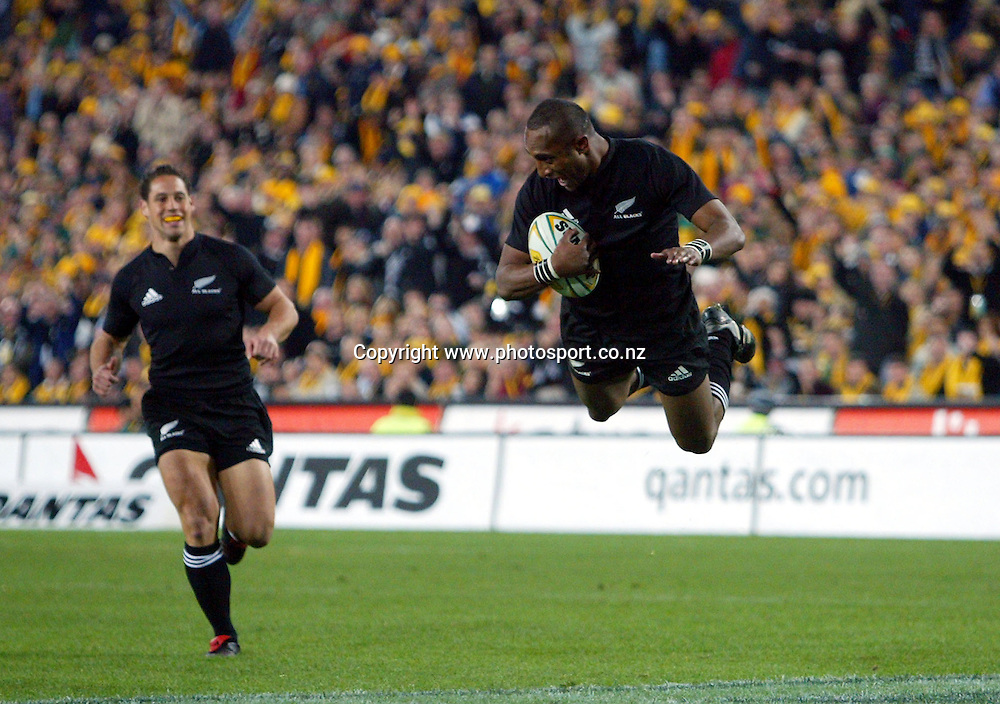 Joe Rokocoko dives into score during the Bledisloe Cup match between the All Blacks and the Wallabies at Telstra Stadium, Sydney, Australia on Saturday 13 August, 2005. The All Blacks won the match 30 - 13. Photo: Hannah Johnston/PHOTOSPORT<br /><br /><br /><br /><br />131677