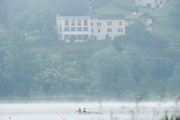 Aiguebelette, FRANCE. CHN W2X, training in the mist on the course at the 2014 FISA World Cup II, 08:45:23  Thursday  19/06/2014. [Mandatory Credit; Peter Spurrier/Intersport-images]