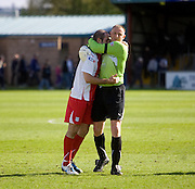 Keeper Rab Douglas gives captain Gary Harkins a hug as Dundee celebrate - Ross County v Dundee - IRN BRU Scottish Football League First Division at Victoria Park<br /> <br /> <br /> <br /> http://www.davidyoungphoto.co.uk