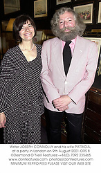 Writer JOSEPH CONNOLLY and his wife PATRICIA, at a party in London on 9th August 2001.ORS 8