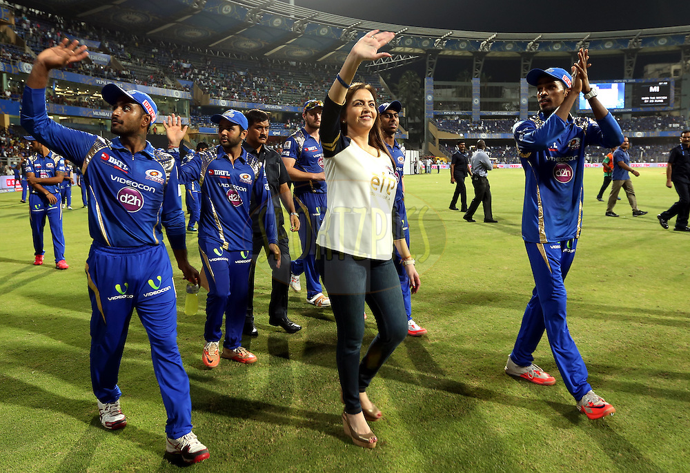 Nita Ambani owner of Mumbai Indians with Mumbai Indians players takes a lap after winning the match 23 of the Pepsi IPL 2015 (Indian Premier League) between The Mumbai Indians and The Sunrisers Hyferabad held at the Wankhede Stadium in Mumbai India on the 25th April 2015.<br /> <br /> Photo by:  Sandeep Shetty / SPORTZPICS / IPL