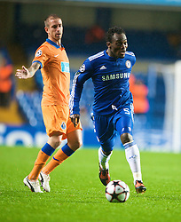 LONDON, ENGLAND - TUESDAY, SEPTEMBER 15th, 2009: Chelsea's Michael Essien and Porto's Raul Meireles during the UEFA Champions League Group D match at Stamford Bridge. (Photo by Chris Brunskill/Propaganda)