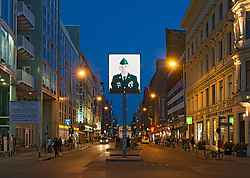 Night view of Checkpoint Charlie in Kreuzberg Berlin Germany