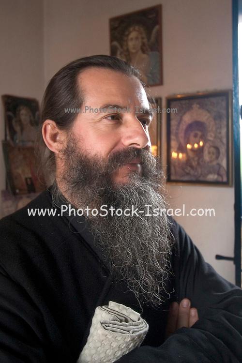 Israel, Capernahum, Monk Arinarchos, inside the Church of the Twelve Apostles Greek Orthodox church