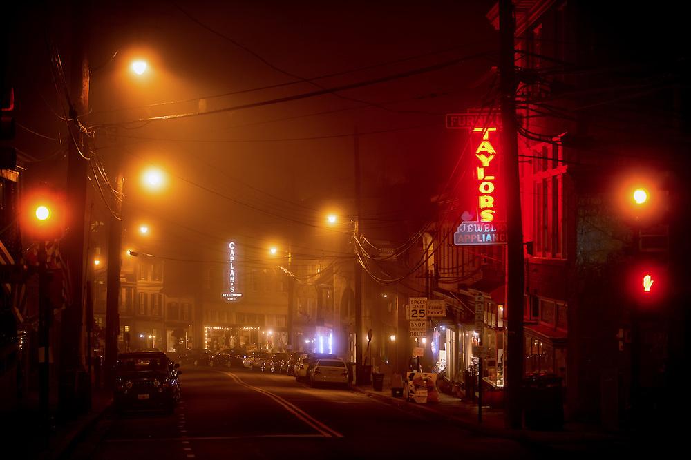 Heavy fog and streetlights on Main Street in Ellicott City, Maryland.