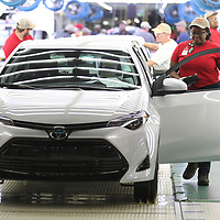 A Toyota Mississippi member gets ready to drive a completed Toyota Corolla off the line in Blue Springs.