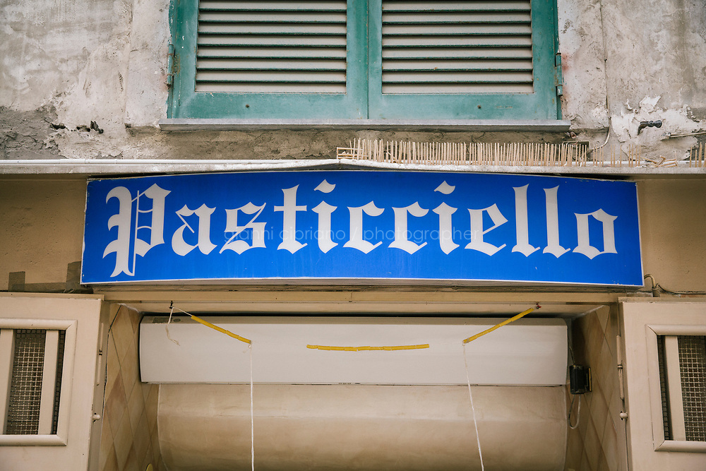NAPLES, ITALY - 7 JUNE 2018: The entrance sign of  Pasticcielo bakery  in Naples, Italy, on June 7th 2018.<br /> <br /> Pasticciello was founded 34 years ago by Lucia Tagliatela.