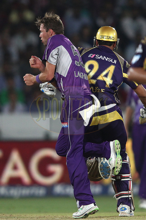 Ben Laughlin of the Hobart Hurricanes walks into Yusuf Pathan of the Kolkata Knight Riders way as he takes a run during the first semi final match of the Oppo Champions League Twenty20 between the Kolkata Knight Riders and the Hobart Hurricanes held at the Rajiv Gandhi Cricket Stadium, Hyderabad, India on the 2nd October 2014<br /> <br /> Photo by:  Shaun Roy / Sportzpics/ CLT20<br /> <br /> <br /> Image use is subject to the terms and conditions as laid out by the BCCI/ CLT20.  The terms and conditions can be downloaded here:<br /> <br /> http://sportzpics.photoshelter.com/gallery/CLT20-Image-Terms-and-Conditions-2014/G0000IfNJn535VPU/C0000QhhKadWcjYs