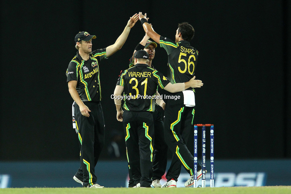 Mitchell Starc celebrates the wicket of Johnson Charles of The West Indies during the ICC World Twenty20 semi final match between Australia and The West Indies held at the Premadasa Stadium in Colombo, Sri Lanka on the 5th October 2012<br /> <br /> Photo by Ron Gaunt/SPORTZPICS