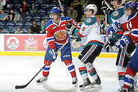 KELOWNA, CANADA, FEBRUARY 15: Curtis Lazar #27 of the Edmonton OIl Kings is checked by Zach Franko #9 of the Kelowna Rockets at the Kelowna Rockets on February 15, 2012 at Prospera Place in Kelowna, British Columbia, Canada (Photo by Marissa Baecker/Shoot the Breeze) *** Local Caption ***