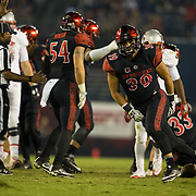 08 October 2016: The San Diego State Aztecs football team open's up the mountain west conference season at home against the University of Nevada Las Vegas Rebels. San Diego State linebacker Ronley Lakalaka (39) seen here after making a defensive stop in the third quarter. The Aztecs beat the Rebels 26-7 to improve to 4-1 and 1-0 in conference play. www.sdsuaztecphotos.com