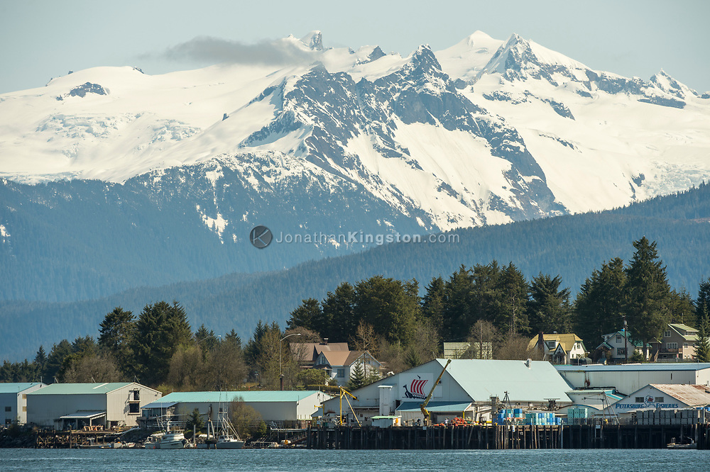 View of Petersburg, Alaska with snow capped peaks in the background.