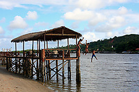 kids jumping in the water from a sundeck in recife pernambuco state brazil