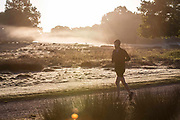 UNITED KINGDOM, London: 12 May 2020 <br /> A jogger makes his way through a frosty Richmond Park early this morning. The weather in the capital, although starting sunny and cold today, is set to be cloudy for the rest of the week.