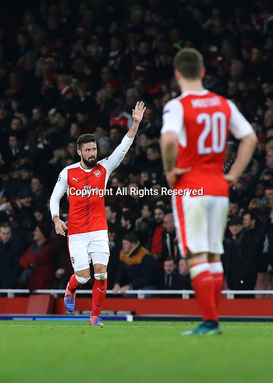 23.11.2016. Emirates Stadium, London, England. UEFA Champions League Football. Arsenal versus Paris Saint Germain. Arsenal Forward Olivier Giroud scores from the spot, and waves to fans as he levels the score, 1-1
