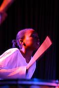 Belo Horizonte_MG, Brasil...Garota, do projeto Alem do Som realizado no Recanto do Menor, tocando percussao em uma apresentacao...A girl, of Alem do Som project realized in Recanto do Menor, playing percussion in a presentation...Foto: LEO DRUMOND / NITRO
