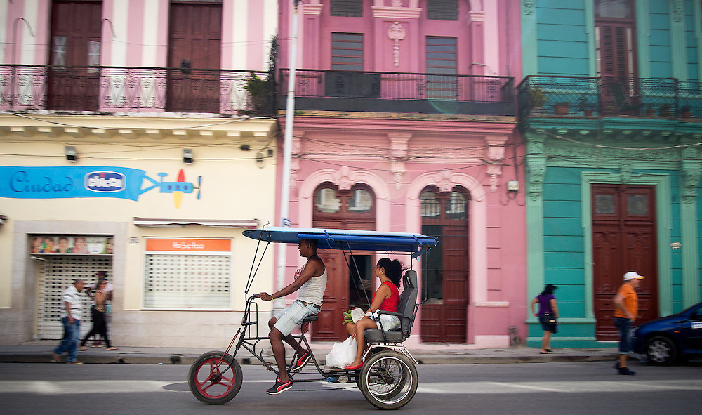 Locals and toursits get around by Bicitaxi in Old Havana, Cuba. It's a great way to see the sights and be close to the action.