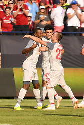 July 28, 2018 - Ann Arbor, MI, U.S. - ANN ARBOR, MI - JULY 28: Liverpool Forward Daniel Sturridge (15) celebrates his goal with teammates Liverpool Midfielder Xherdan Shaqiri (23) and Liverpool Defender Curtis Jones (48) in the second half of the ICC soccer match between Manchester United FC and Liverpool FC on July 28, 2018 at Michigan Stadium in Ann Arbor, MI (Photo by Allan Dranberg/Icon Sportswire) (Credit Image: © Allan Dranberg/Icon SMI via ZUMA Press)