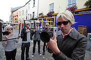 BECOMING ANDY WARHOL! FRAMING THE VISUAL ARTS PROGRAMME AT GALWAY ARTS FESTIVAL..A group of Andy Warhol look-a-likes were on Quay St. Galway to launch the Visual Arts Programme of the Galway Arts Festival 2010, and to honour of the 'Father of Pop Art' who was the first artist to produce a creative collaborate with ABSOLUT in 1985.   Today's Warhol's will feature in a pop-art film by audio-visual artist Phil RetroSpector, a creative collaboration with ABSOLUT that expands the Visual Arts Programme this year from galleries to online spaces, a first time move for the Festival. Central to this year's programme is the introduction of a spectacular new temporary gallery, the Festival Fairgreen Gallery, just off Eyre Square, housed in a new building with an amazing glass façade and a beautiful flood of natural light.