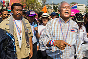 05 JANUARY 2014 - BANGKOK, THAILAND: SUTHEP THAUGSUBAND, leader of the anti-government movement, leads a march through Bangkok Sunday. Suthep is a former Deputy Prime Minister and member of the opposition Democrat Party who resigned to organize the protests against the Pheu Thai government.  He led the protestors on a march through the Chinatown district of Bangkok. Tens of thousands of people waving Thai flags and blowing whistles gridlocked what was already one of the most congested parts of the city. The march was intended to be a warm up to their plan by protestors to completely shut down Bangkok starting Jan. 13.     PHOTO BY JACK KURTZ