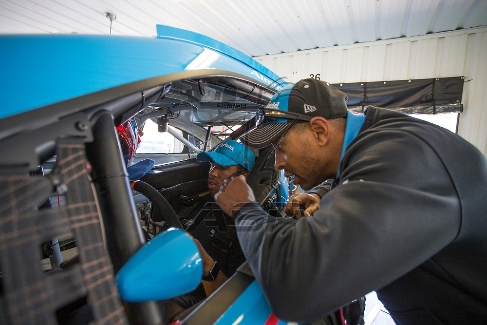 June 09, 2017 - Long Pond, PA, USA: Darrell Wallace, Jr. (43) hangs out with his crew members and gets fitted in the car prior to practice for the Pocono 400 at Pocono Raceway in Long Pond, PA.