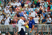 Jason Day (right) celebrates with his caddy Colin Swatton (left) after winning The Barclays Championship held at Plainfield Country Club in Edison, New Jersey on August 30.