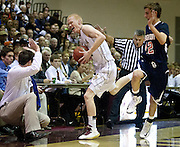 Lone Peak's T.J. Haws (11) is pushed out of bounds during the high school basketball game between Brighton and Lone Peak in Highland, Wednesday, Nov. 28, 2012.