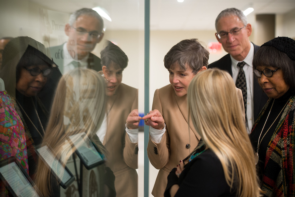 Cathy Levy, center, wife of David Levy, looks at historical women's wear as the members of the Ohio University Foundation Board of Trustees take a tour of the newly renovated McCracken Hall prior to the portrait unveilings of President McDavis and his wife, Mrs. McDavis, on February 9, 2017.