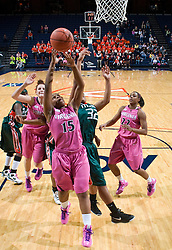 Virginia guard Ariana Moorer (15) shoots past Miami (FL) guard Epiphany Woodson (32).  The #21 ranked Virginia Cavaliers defeated the Miami Hurricanes 85-74 in overtime at the John Paul Jones Arena in Charlottesville, VA on February 19, 2009.