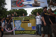 Activists hold a banner depicting slain anti-mining activist Marcelo Rivera while chanting anti-mining slogans during the VIII Festival for sovereignty and the People's right to self-determination in San Isidro's central park. Pacific Rim's controversial El Dorado gold mine has been the focus of numerous social conflicts at local and national level. Three anti-mining local leaders were murdered in 2009. While a year before, former president Antonio Saca refused to authorize the company's mining permit. This action prompted Pacific Rim to invoked a provision of the Central American Free Trade Agreement (CAFTA) to place the matter in the hands of an international arbitration court. Oceana Gold, who took over Pacific Rim on October 2013 for US $10.2 million , now seeks US $300 million for damages agains the State of El Salvador. San Isidro, Cabañas, El Salvador. September 15, 2014.