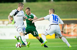 Enes Rujovic #21 of Krsko vs Marko Jakolic #20 of Celje and Jure Travner #16 of Celje during football match between NK Krsko and NK Celje in 1st Round of Prva liga Telekom Slovenije 2015/16, on July 19, 2015 in Stadium Matije Gubca, Krsko, Slovenia. Photo by Vid Ponikvar / Sportida