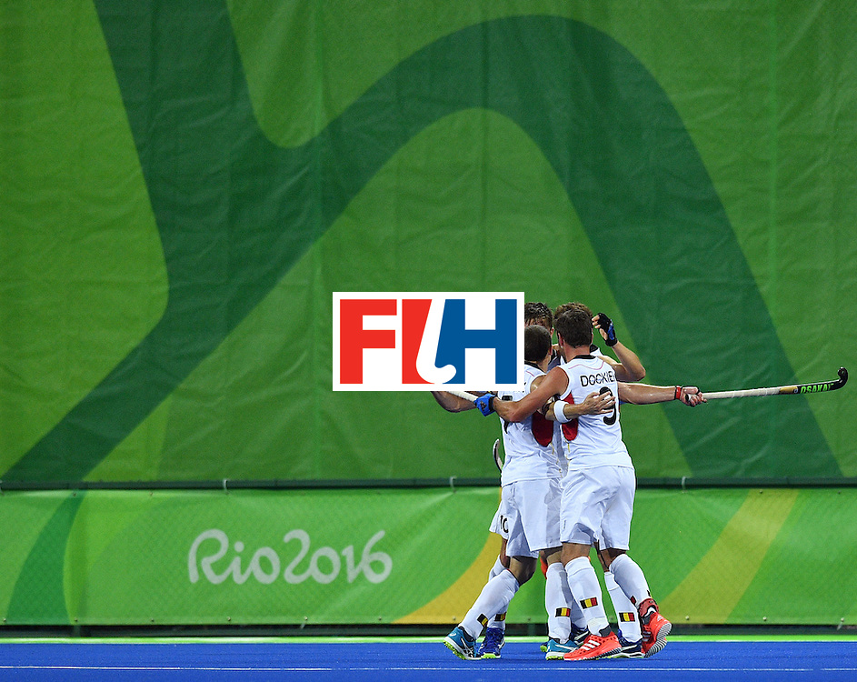 Belgium's John John Dohmen (L) celebrates a goal with teammates during the men's semifinal field hockey Belgium vs Netherlands match of the Rio 2016 Olympics Games at the Olympic Hockey Centre in Rio de Janeiro on August 16, 2016.  / AFP / Carl DE SOUZA        (Photo credit should read CARL DE SOUZA/AFP/Getty Images)