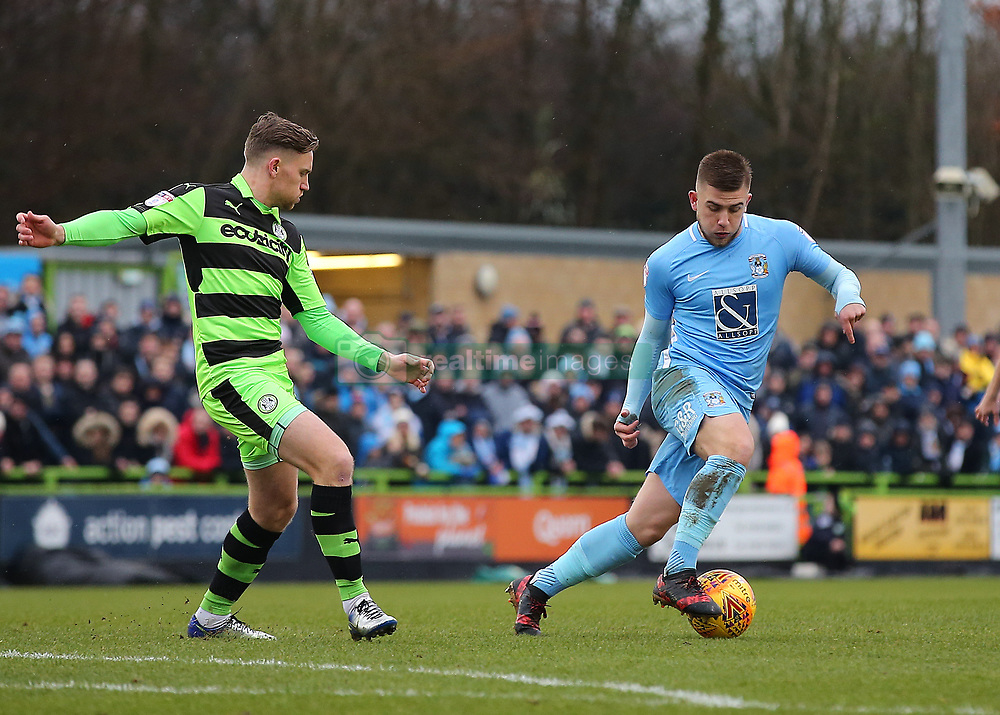 Coventry City's Josh Barrett shields the ball as he switches play