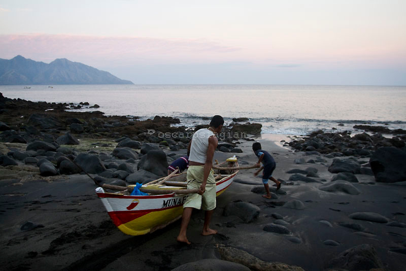 villager try to pushed the canoe into the sea for fishing, Residents in the lamalera village, Indonesia cathing  sperm whales with traditional method to provide meals for the entire village and part of the Lembata island where the village is located..