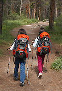 Two girls backpacking at Valley of the Five Lakes in Jasper National Park, Canada