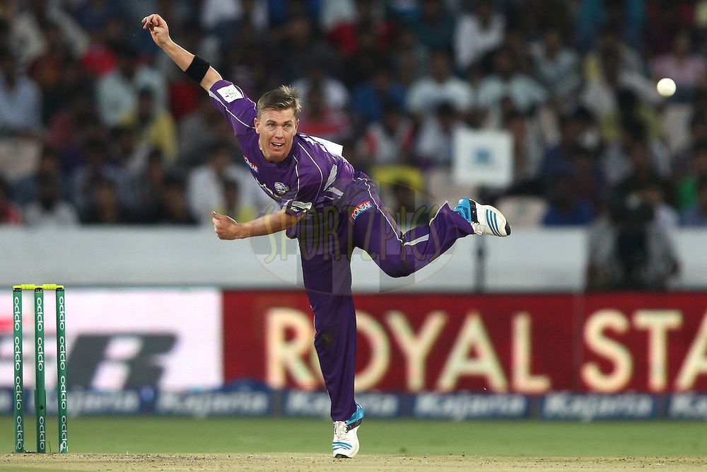 Xavier Doherty of the Hobart Hurricanes sends down a delivery during the first semi final match of the Oppo Champions League Twenty20 between the Kolkata Knight Riders and the Hobart Hurricanes held at the Rajiv Gandhi Cricket Stadium, Hyderabad, India on the 2nd October 2014<br /> <br /> Photo by:  Shaun Roy / Sportzpics/ CLT20<br /> <br /> <br /> Image use is subject to the terms and conditions as laid out by the BCCI/ CLT20.  The terms and conditions can be downloaded here:<br /> <br /> http://sportzpics.photoshelter.com/gallery/CLT20-Image-Terms-and-Conditions-2014/G0000IfNJn535VPU/C0000QhhKadWcjYs