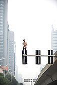 A Man Jumps From Signal Lamp In China
