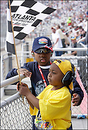 HAMPTON -  Young Nascar fans Cordell Dixon Jr. (8) and David Gulley II (5) , Decatur,  look for their favorite drivers from  the Grandstand at Atlanta Motor Speedway on Sunday,  March 8, 2009 during the Kobalt Tools 500 .JOHNNY CRAWFORD