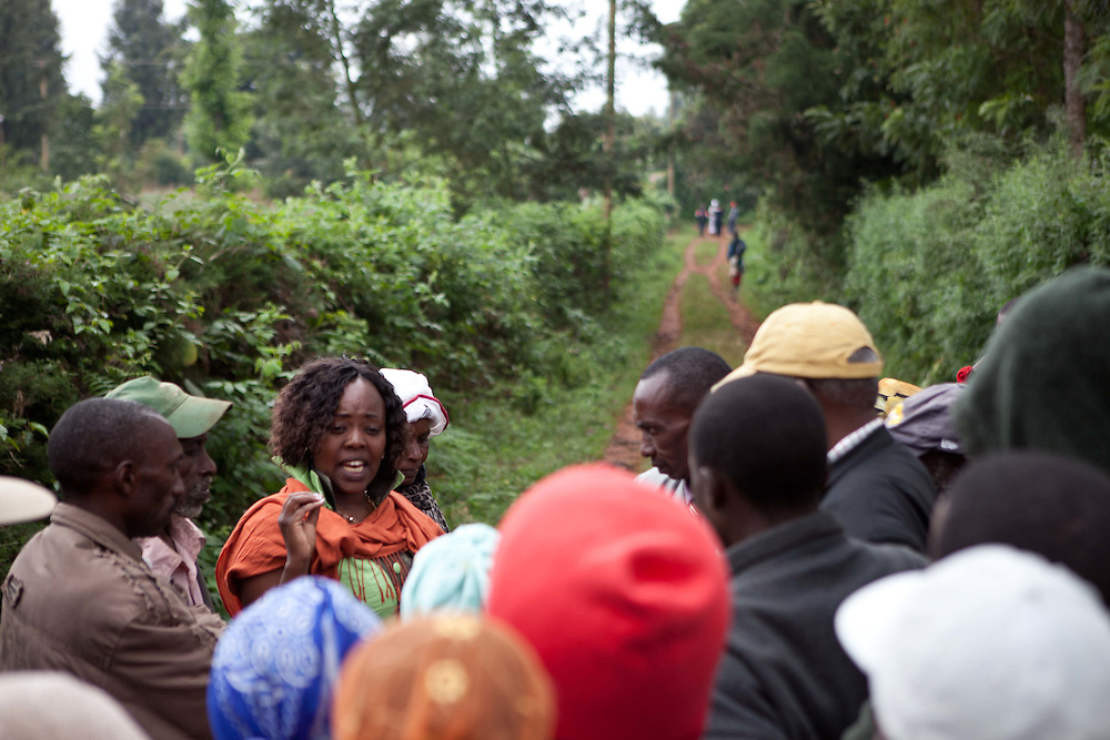 At the conclusion of the tea farm visit, Cathy takes times to talk with tea farm workers to learn more about their concerns as well as to answer questions about what she will do for them when elected to office.
