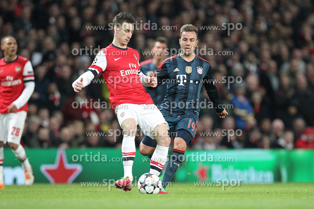 19.02.2014, Emirates Stadion, London, ENG, UEFA CL, FC Arsenal vs FC Bayern Muenchen, Achtelfinale, im Bild l-r: im Zweikampf, Aktion, mit Laurent KOSCIELNY #6 (FC Arsenal London), Mario GOETZE #19 (FC Bayern Muenchen) // during the UEFA Champions League Round of 16 match between FC Arsenal and FC Bayern Munich at the Emirates Stadion in London, Great Britain on 2014/02/19. EXPA Pictures © 2014, PhotoCredit: EXPA/ Eibner-Pressefoto/ Kolbert<br /> <br /> *****ATTENTION - OUT of GER*****