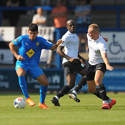 TELFORD COPYRIGHT MIKE SHERIDAN Kaiman Anderson (formerly of AFC Telford) holds off Jon Royle of Telford during the National League North fixture between AFC Telford United and Leamington AFC at the New Bucks Head on Monday, August 26, 2019<br /> <br /> Picture credit: Mike Sheridan<br /> <br /> MS201920-005