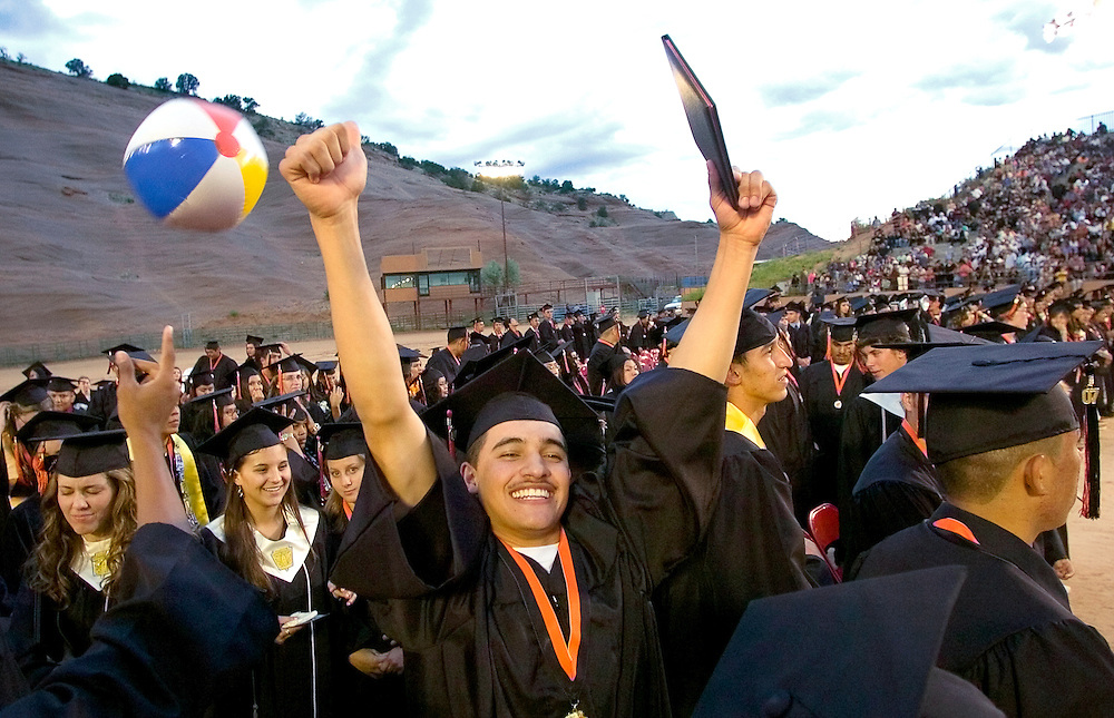 051807     Brian Leddy.Gallup High School graduate Josh Fischer celebrates after receiving his diploma at  Red Rock Park on Friday. Over 350 students graduated from the school this year.